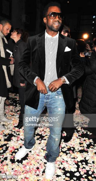 Singer Kanye West attends the Givenchy fashion show during Paris Fashion Week Haute Couture Spring/Summer 2009 at Couvent des Cordeliers on January...