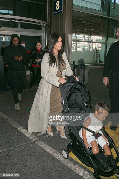 Singer Kanye West his wife Kim Kardashian West and their baby North are seen at the CharlesdeGaulle airport on April 14 2015 in Paris France