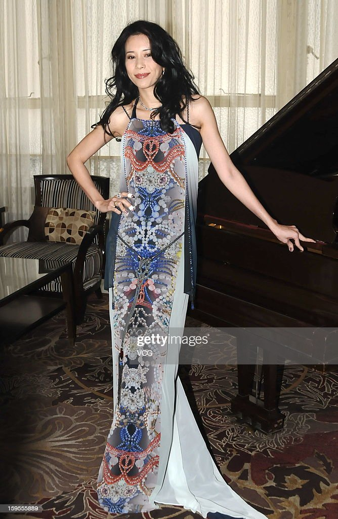 Singer <a gi-track='captionPersonalityLinkClicked' href=/galleries/search?phrase=Karen+Mok&family=editorial&specificpeople=574429 ng-click='$event.stopPropagation()'>Karen Mok</a> attends a press conference to promote her new album 'Somewhere I Belong' at Peace Hotel on January 15, 2013 in Shanghai, China.