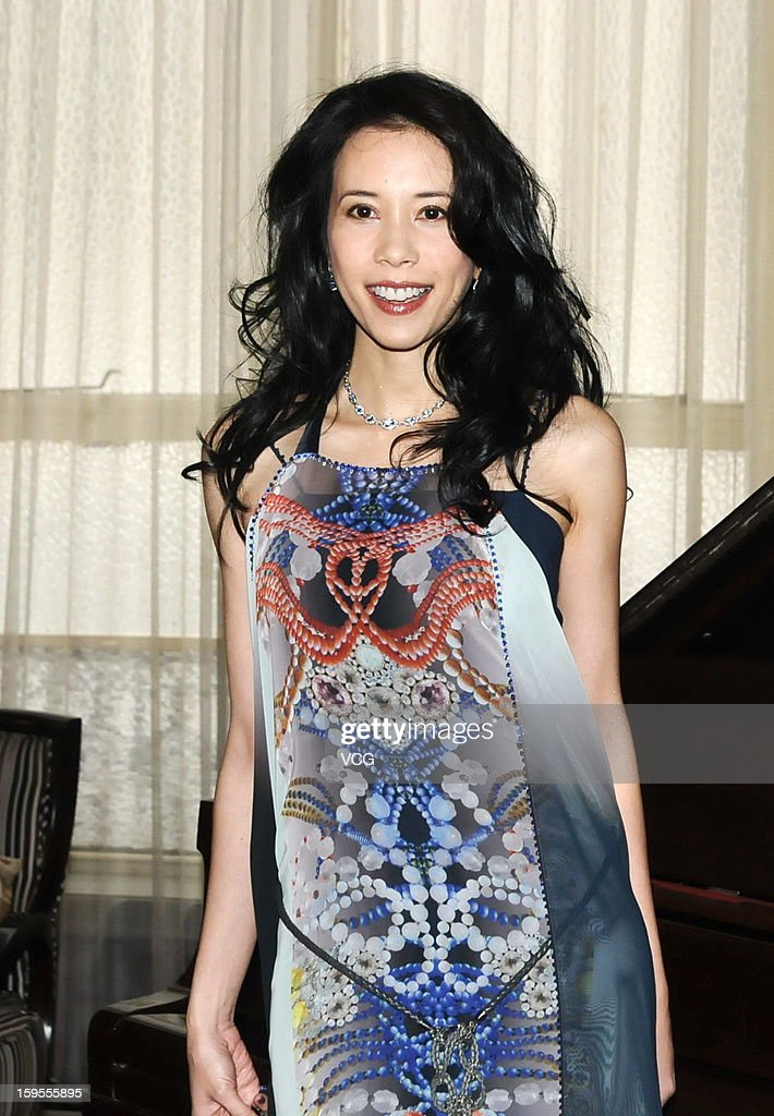 Singer Karen Mok attends a press conference to promote her new album 'Somewhere I Belong' at Peace Hotel on January 15, 2013 in Shanghai, China.