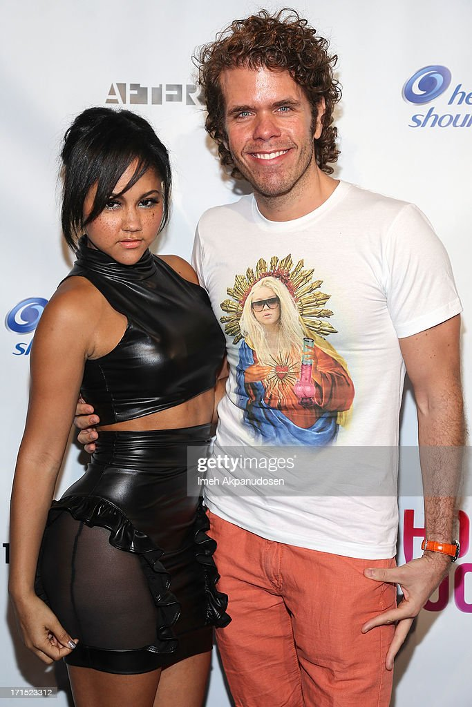 Singer Kat DeLuna (L) and Perez Hilton attends Logo's 'Hot 100' Party at Drai's Lounge in W Hollywood on June 25, 2013 in Hollywood, California.