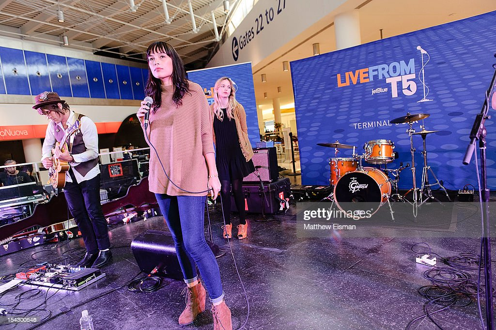 Singer Kate Earl (C) performs for the CMJ Music Marathon at JetBlue's 'Live From T5 Concert Series' in John F. Kennedy International Airport on October 17, 2012 in New York City.