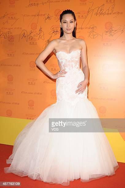 Singer Kate Tsui Tszshan attends the 11th Huading Global Music Satisfaction Survey Release Ceremony at Shanghai Expo Centre on December 18 2013 in...
