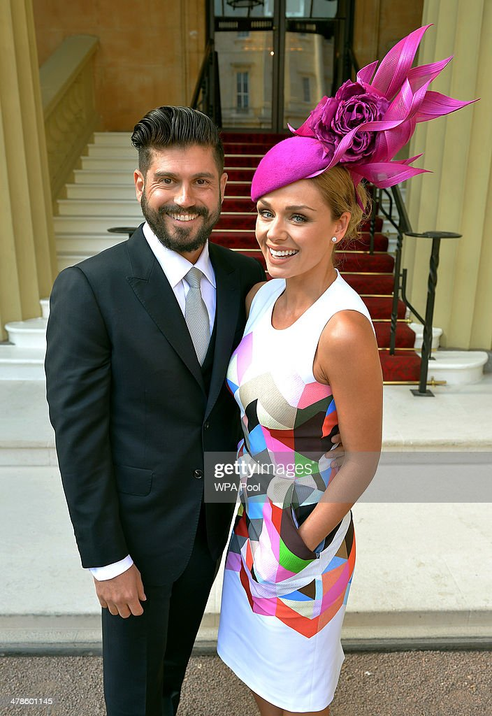 Singer Katherine Jenkins and her partner Andrew Levitas arrive at Buckingham Palace in central London for an Investiture Ceremony where she will receive an OBE (Officer of the Order of the British Empire) on March 14, 2014 in London, England.