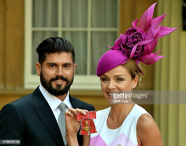 Singer Katherine Jenkins holds her OBE and her partner Andrew Levitas during an Investiture Ceremony at Buckingham Palace on March 14 2014 in London...