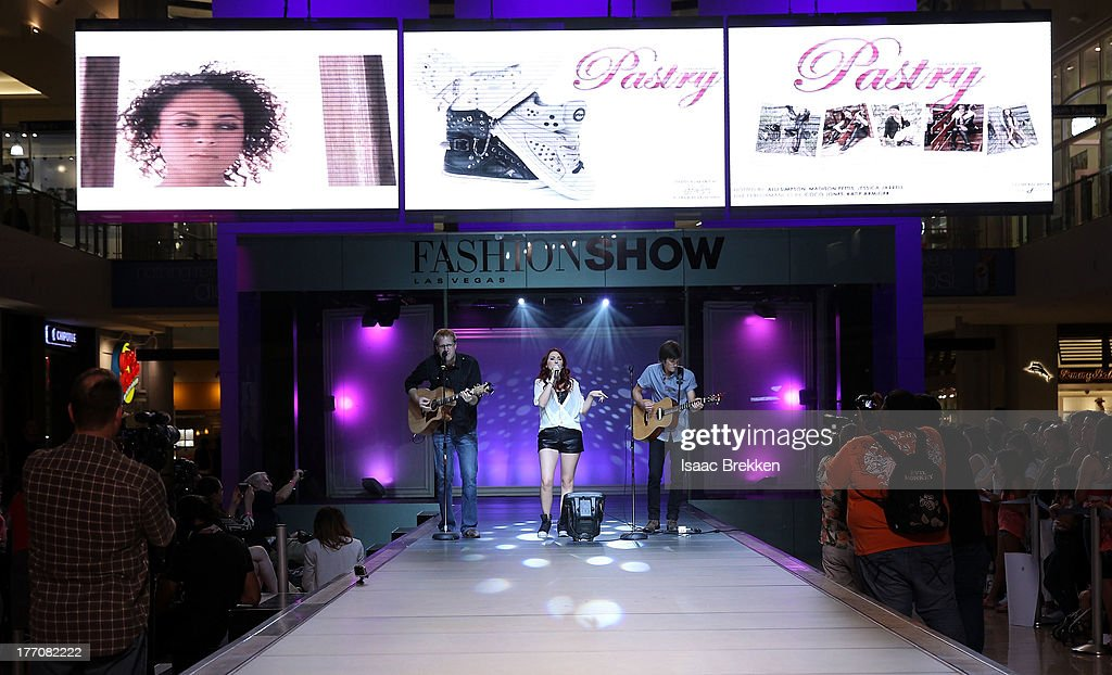 Singer <a gi-track='captionPersonalityLinkClicked' href=/galleries/search?phrase=Katie+Armiger&family=editorial&specificpeople=4617947 ng-click='$event.stopPropagation()'>Katie Armiger</a> performs during the Pastry Fashion Show with 1U mission at the Fashion Show mall on August 20, 2013 in Las Vegas, Nevada.