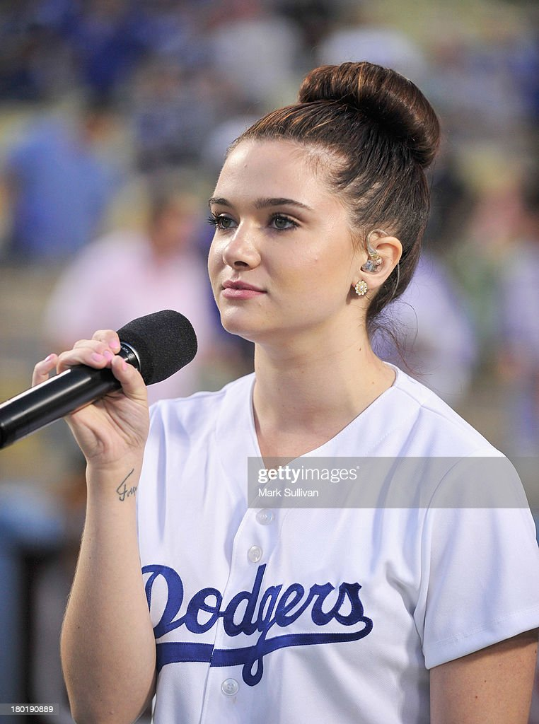 Singer <a gi-track='captionPersonalityLinkClicked' href=/galleries/search?phrase=Katie+Stevens&family=editorial&specificpeople=6749187 ng-click='$event.stopPropagation()'>Katie Stevens</a> sings the national anthem before the MLB game between the Arizona Diamondbacks and Los Angeles Dodgers at Dodger Stadium on September 9, 2013 in Los Angeles, California.