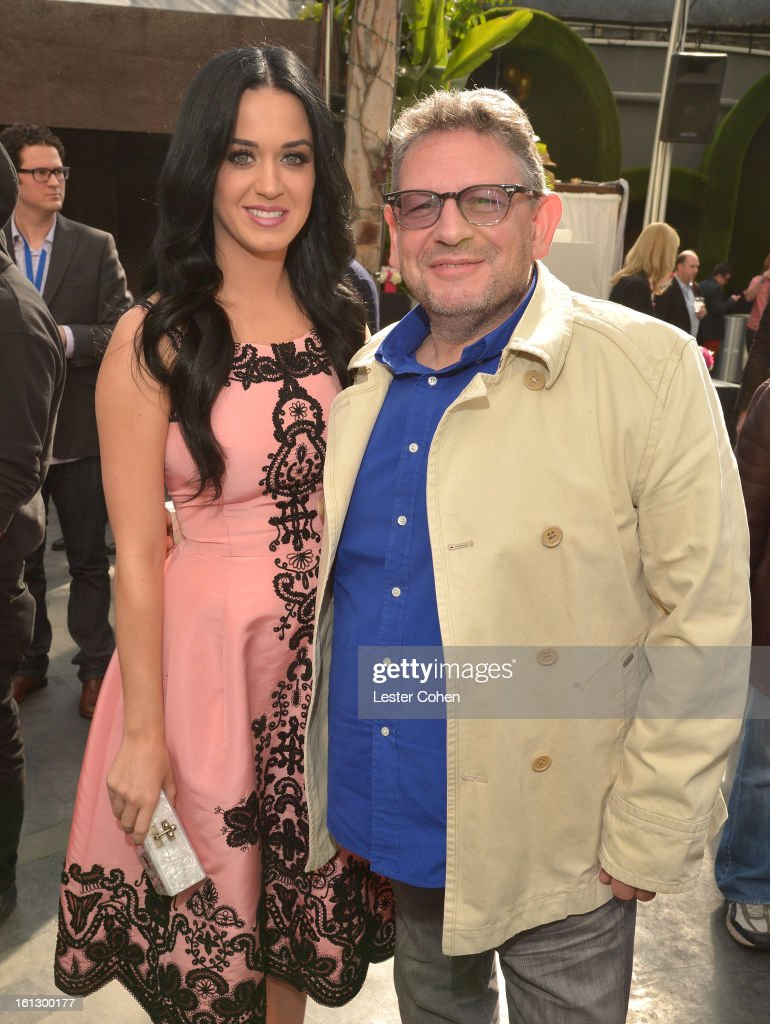 Singer <a gi-track='captionPersonalityLinkClicked' href=/galleries/search?phrase=Katy+Perry&family=editorial&specificpeople=599558 ng-click='$event.stopPropagation()'>Katy Perry</a> (L) and Chairman/CEO of Universal Music International <a gi-track='captionPersonalityLinkClicked' href=/galleries/search?phrase=Lucian+Grainge&family=editorial&specificpeople=813742 ng-click='$event.stopPropagation()'>Lucian Grainge</a> attend Universal Music Group Showcase '13 Backstage at Lure on February 9, 2013 in Hollywood, California.