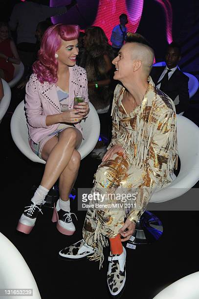 Singer Katy Perry and designer Jeremy Scott pose in the VIP Glamour area during the MTV Europe Music Awards 2011 at Odyssey Arena on November 6 2011...