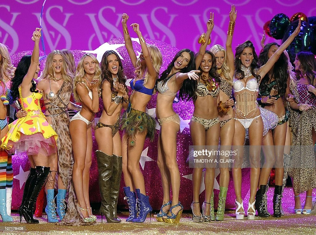 Singer <a gi-track='captionPersonalityLinkClicked' href=/galleries/search?phrase=Katy+Perry&family=editorial&specificpeople=599558 ng-click='$event.stopPropagation()'>Katy Perry</a> (yellow dress) appears on stage with models at the end of the 2010 Victoria's Secret Fashion Show at the Lexington Armory in New York November 10, 2010. The show will be broadcast November 30,2010 on CBS.