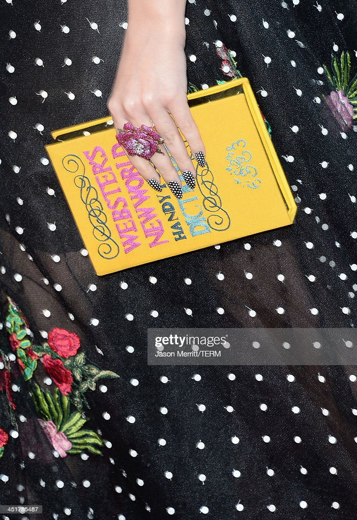 Singer Katy Perry (clutch detail) attends the 2013 American Music Awards at Nokia Theatre L.A. Live on November 24, 2013 in Los Angeles, California.