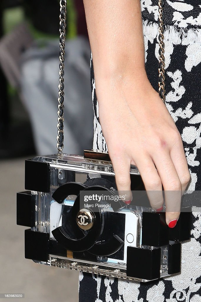 Singer <a gi-track='captionPersonalityLinkClicked' href=/galleries/search?phrase=Katy+Perry&family=editorial&specificpeople=599558 ng-click='$event.stopPropagation()'>Katy Perry</a> (handbag detail) attends the Chanel show as part of the Paris Fashion Week Womenswear Spring/Summer 2014 on October 1, 2013 in Paris, France.