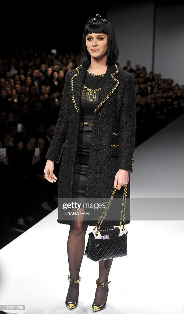 US singer Katy Perry attends the show or fashion house Moschino as part of the Milan's Women's fashion week Autumn/Winter 2014 collections on February 20, 2014.