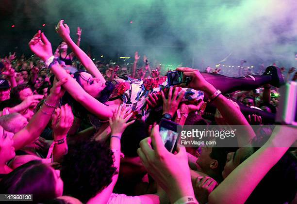 Singer Katy Perry crowd surfs while singe Rihanna perform with Calvin Harris during Day 3 of the 2012 Coachella Valley Music Arts Festival held at...