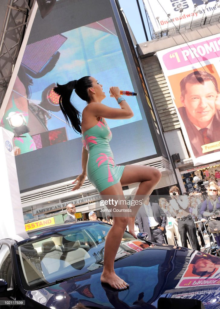 Singer Katy Perry performs atop the new 2011 Volkswagen Jetta Compact Sedan at the world premiere of Volkswagen's new Jetta compact sedan at Times Square on June 15, 2010 in New York City.