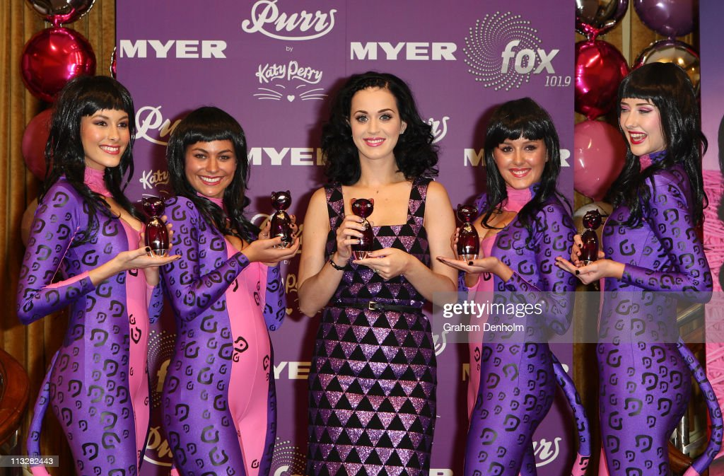 Singer <a gi-track='captionPersonalityLinkClicked' href=/galleries/search?phrase=Katy+Perry&family=editorial&specificpeople=599558 ng-click='$event.stopPropagation()'>Katy Perry</a> (C) poses at the launch of her new fragrance 'Purr' at Myer, Bourke Street on April 30, 2011 in Melbourne, Australia.