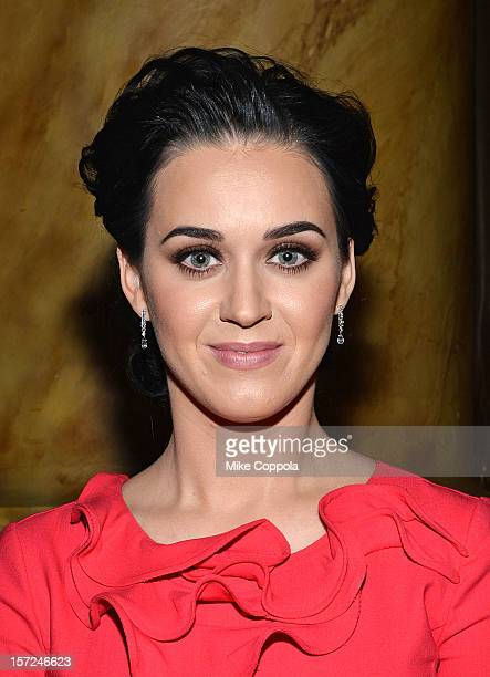 Singer Katy Perry poses with her Billboard Woman of The Year award at the 2012 Billboard Women In Music Luncheon at Capitale on November 30 2012 in...