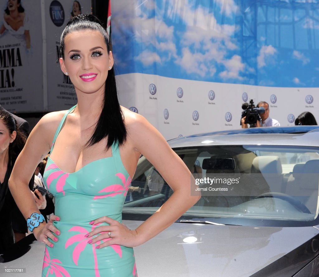 Singer Katy Perry poses with new 2011 Volkswagen Jetta Compact Sedan at the world premiere of Volkswagen's new Jetta compact sedan at Times Square on June 15, 2010 in New York City.