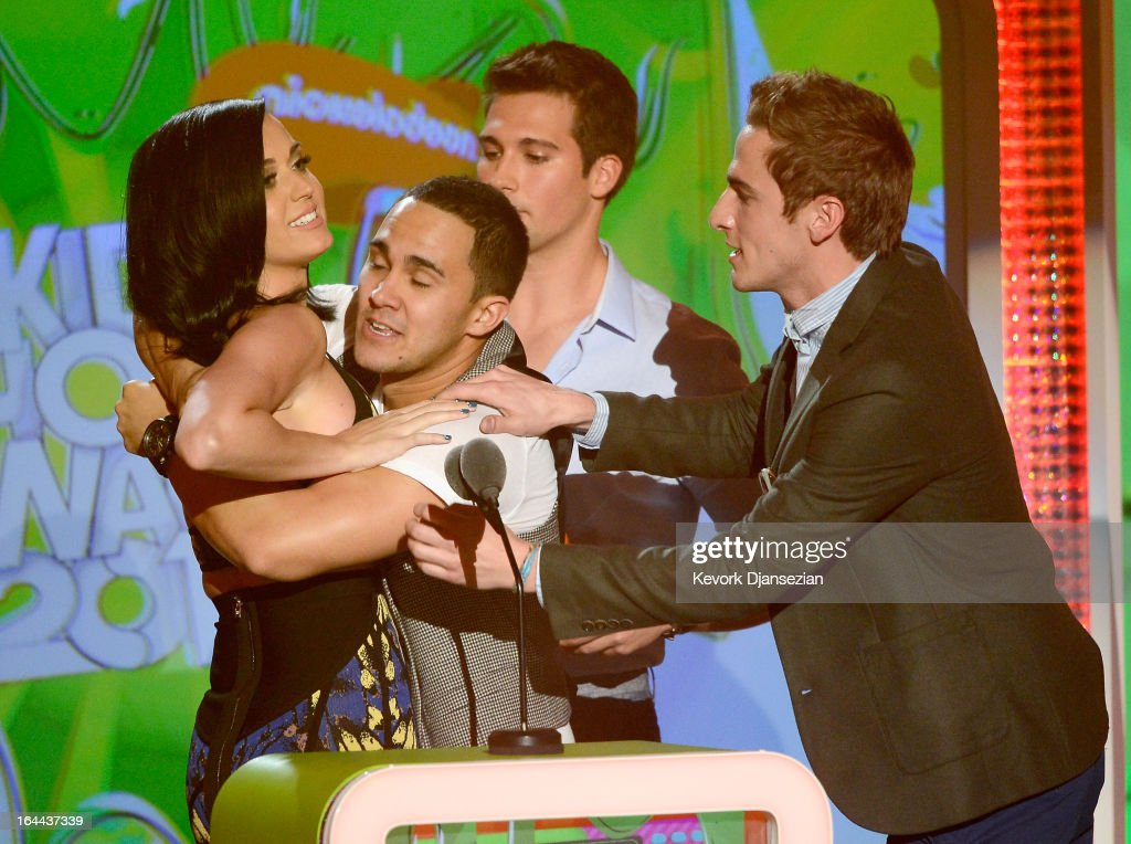 Singer Katy Perry, winner of Favorite Female Singer, with singers (L-R) Carlos Pena Jr., James Maslow and Kendall Schmidt of Big Time Rush speak onstage during Nickelodeon's 26th Annual Kids' Choice Awards at USC Galen Center on March 23, 2013 in Los Angeles, California.