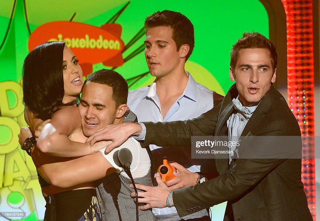 Singer Katy Perry, winner of Favorite Female Singer, with singers (L-R) Carlos Pena Jr., Jason Maslow and Kendall Schmidt of Big Time Rush speak onstage during Nickelodeon's 26th Annual Kids' Choice Awards at USC Galen Center on March 23, 2013 in Los Angeles, California.