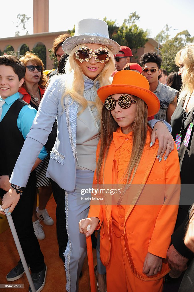 Singer Ke$ha (L) and brother Louie Sebert arrive at Nickelodeon's 26th Annual Kids' Choice Awards at USC Galen Center on March 23, 2013 in Los Angeles, California.