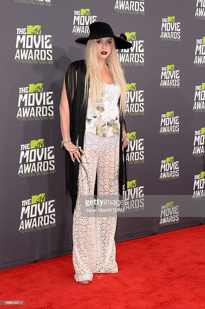 Singer Ke$ha arrives at the 2013 MTV Movie Awards at Sony Pictures Studios on April 14, 2013 in Culver City, California.