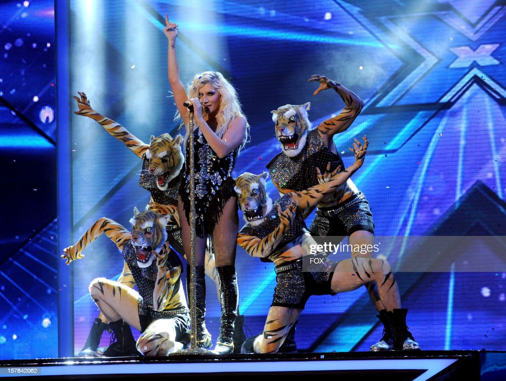 Singer <a gi-track='captionPersonalityLinkClicked' href=/galleries/search?phrase=Ke%24ha&family=editorial&specificpeople=6718222 ng-click='$event.stopPropagation()'>Ke$ha</a> performs onstage at FOX's 'The X Factor' Season 2 Top 6 to 4 Live Elimination Show on December 6, 2012 in Hollywood, California.