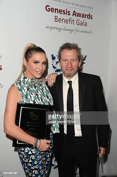 Singer Ke$ha poses backstage after receiving The Wyler Award with director Ken Kwapis at The Humane Society of the United States 2013 Genesis Awards...