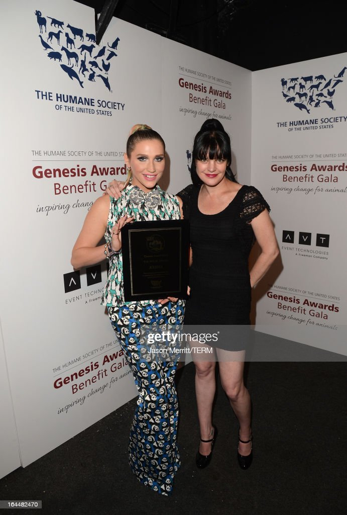 Singer Ke$ha poses backstage, after receiving The Wyler Award, with presenter actress Pauley Perrette at The Humane Society of the United States 2013 Genesis Awards Benefit Gala at The Beverly Hilton Hotel on March 23, 2013 in Los Angeles, California.