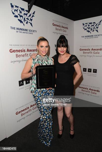 Singer Ke$ha poses backstage after receiving The Wyler Award with presenter actress Pauley Perrette at The Humane Society of the United States 2013...