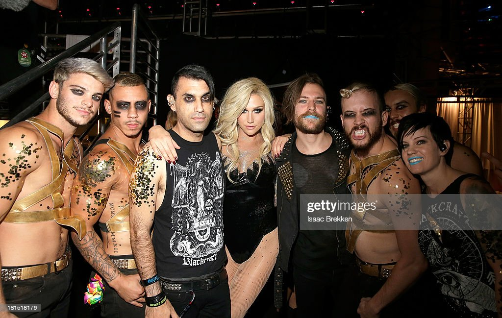 Singer Ke$ha (C) poses with her dancers during the iHeartRadio Music Festival at the MGM Grand Garden Arena on September 21, 2013 in Las Vegas, Nevada.
