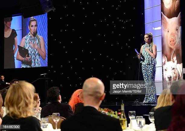 Singer Ke$ha receives The Wyler Award onstage at The Humane Society of the United States 2013 Genesis Awards Benefit Gala at The Beverly Hilton Hotel...