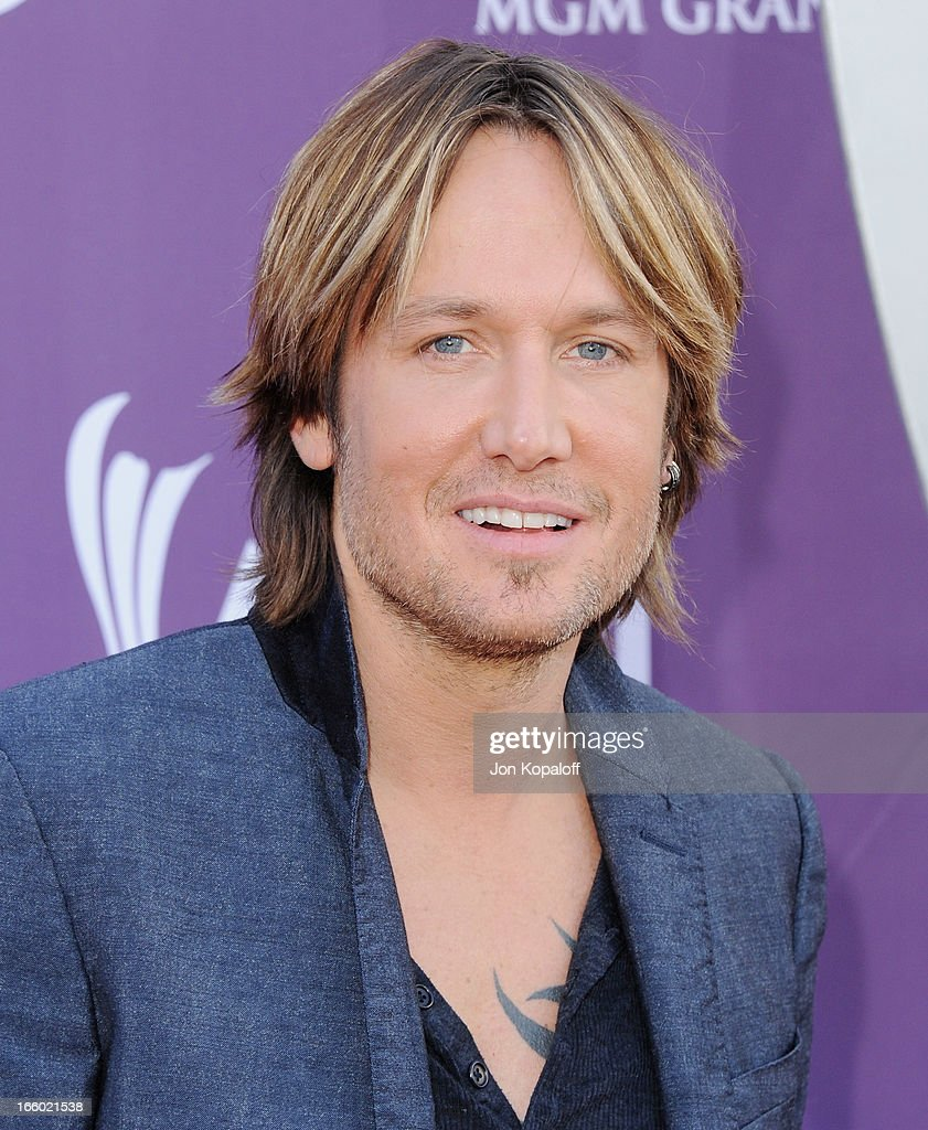 Singer <a gi-track='captionPersonalityLinkClicked' href=/galleries/search?phrase=Keith+Urban&family=editorial&specificpeople=202997 ng-click='$event.stopPropagation()'>Keith Urban</a> arrives at the 48th Annual Academy Of Country Music Awards at MGM Grand Garden Arena on April 7, 2013 in Las Vegas, Nevada.