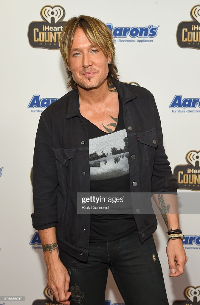 Singer <a gi-track='captionPersonalityLinkClicked' href=/galleries/search?phrase=Keith+Urban&family=editorial&specificpeople=202997 ng-click='$event.stopPropagation()'>Keith Urban</a> attends the 2016 iHeartCountry Festival at The Frank Erwin Center on April 30, 2016 in Austin, Texas.