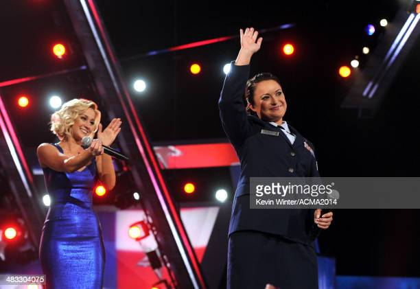 Singer Kellie Pickler and Staff Sgt Baily Zimmerman perform onstage during ACM Presents An AllStar Salute To The Troops at the MGM Grand Garden Arena...