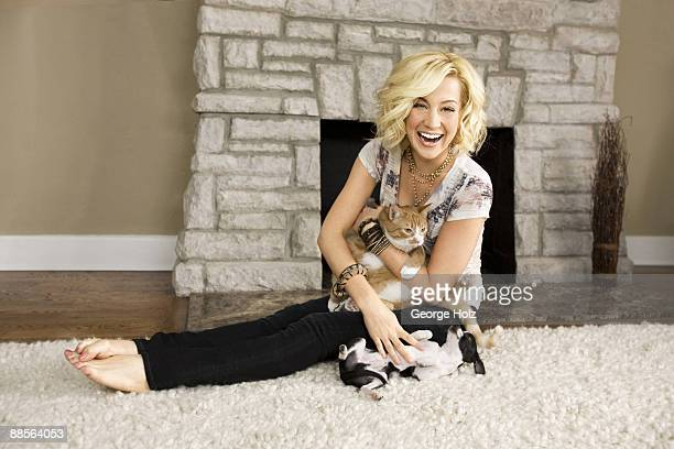 Singer Kellie Pickler poses at a portrait session with dog MooMoo cat Pickles and snake Boots at her home in Nashville TN Published image