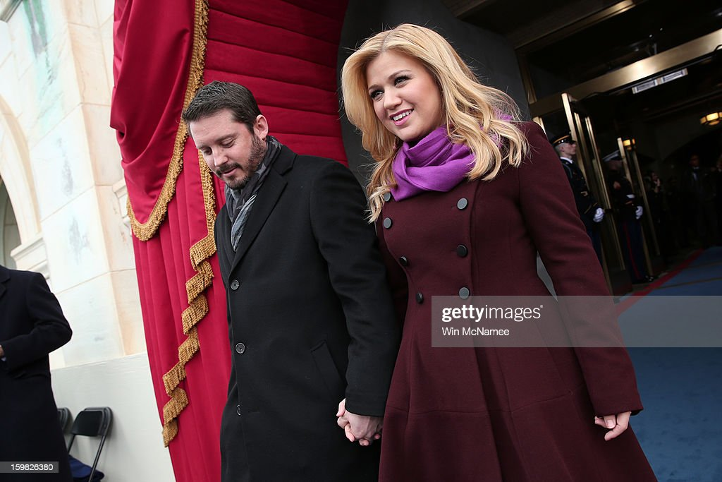 Singer Kelly Clarkson and Brandon Blackstock arrive at the presidential inauguration on the West Front of the U.S. Capitol January 21, 2013 in Washington, DC. Barack Obama was re-elected for a second term as President of the United States.
