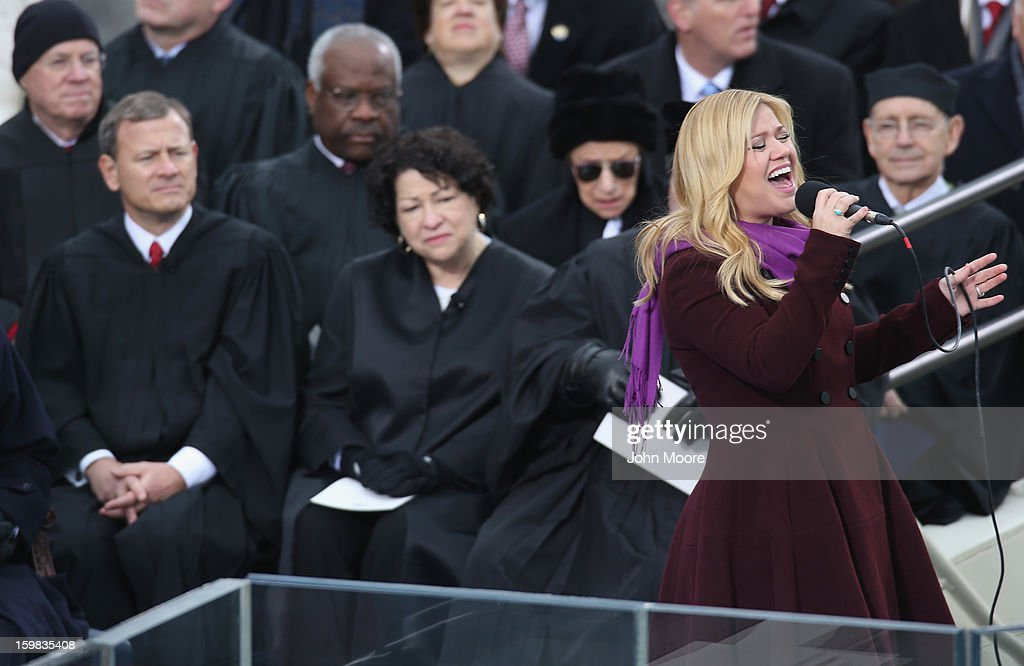 Singer Kelly Clarkson (R) performs as Supreme Court Justices watch during the public ceremonial inauguration for U.S. President Barack Obama on the West Front of the U.S. Capitol January 21, 2013 in Washington, DC. Barack Obama was re-elected for a second term as President of the United States.
