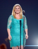 Singer Kelly Clarkson performs onstage during the 48th Annual Academy of Country Music Awards at the MGM Grand Garden Arena on April 7 2013 in Las...