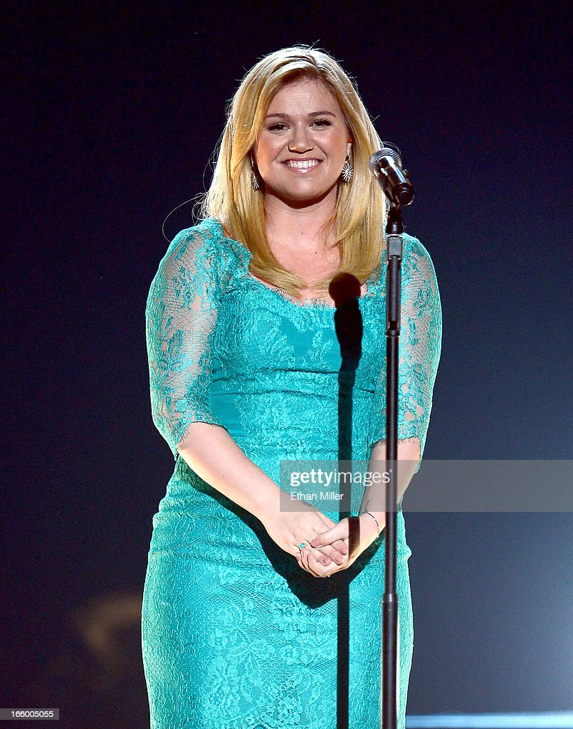 Singer <a gi-track='captionPersonalityLinkClicked' href=/galleries/search?phrase=Kelly+Clarkson&family=editorial&specificpeople=201555 ng-click='$event.stopPropagation()'>Kelly Clarkson</a> performs onstage during the 48th Annual Academy of Country Music Awards at the MGM Grand Garden Arena on April 7, 2013 in Las Vegas, Nevada.