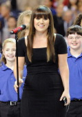 Singer Kelly Clarkson performs the national anthem during the Bridgestone Super Bowl XLVI Pregame Show at Lucas Oil Stadium on February 5 2012 in...