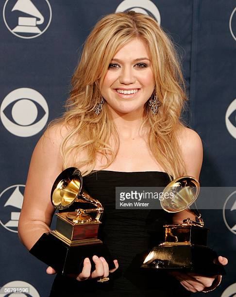 Singer Kelly Clarkson poses with her Best Pop Vocal Album and Best Female Pop Vocal Performace awards in the press room at the 48th Annual Grammy...