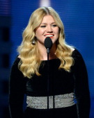 Singer Kelly Clarkson speaks onstage at the 55th Annual GRAMMY Awards at Staples Center on February 10 2013 in Los Angeles California
