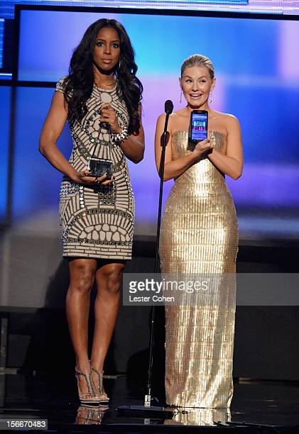 Singer Kelly Rowland and actress Elisha Cuthbert speak onstage during the 40th Anniversary American Music Awards held at Nokia Theatre LA Live on...
