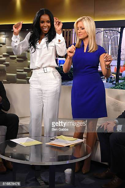 Singer Kelly Rowland and cohost Ainsley Earhardt dance during 'Fox And Friends' at FOX Studios on March 21 2016 in New York City