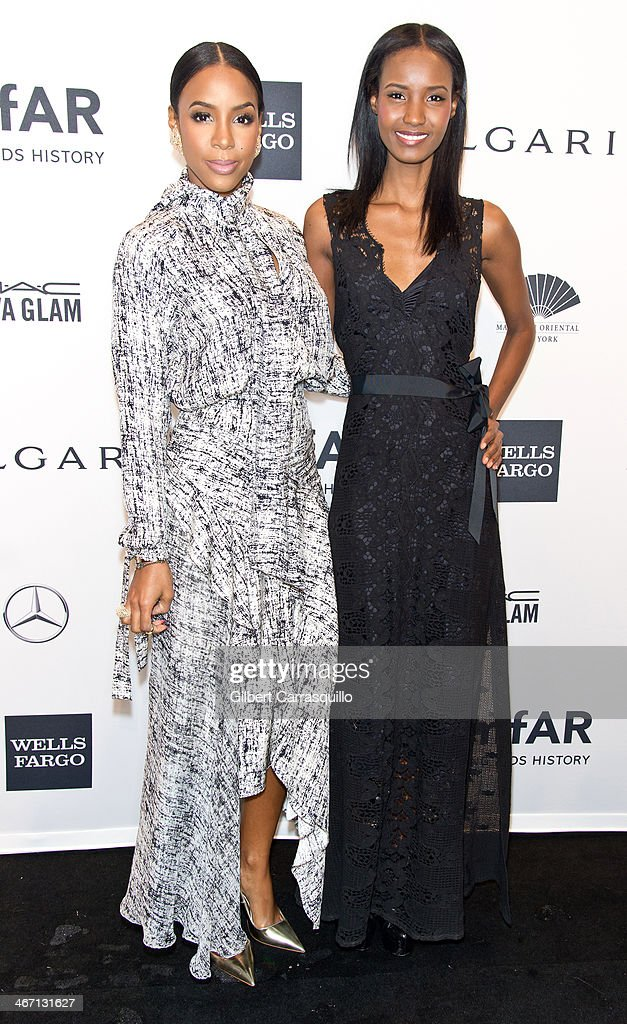 Singer Kelly Rowland and model Fatima Siad attend the 2014 amfAR New York Gala at Cipriani Wall Street on February 5, 2014 in New York City.