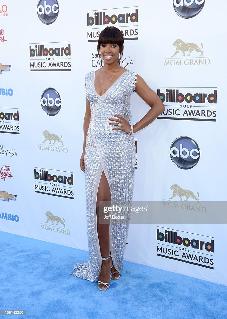 Singer Kelly Rowland arrives at the 2013 Billboard Music Awards at the MGM Grand Garden Arena on May 19, 2013 in Las Vegas, Nevada.