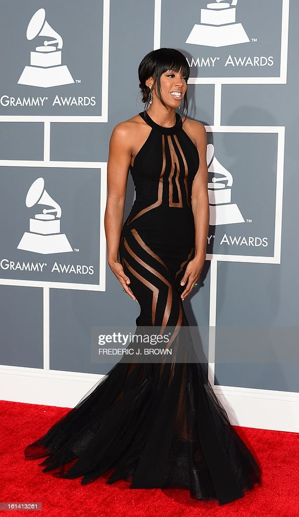 Singer Kelly Rowland arrives on the red carpet at the Staples Center for the 55th Grammy Awards in Los Angeles, California, February 10, 2013. AFP PHOTO Frederic J. BROWN