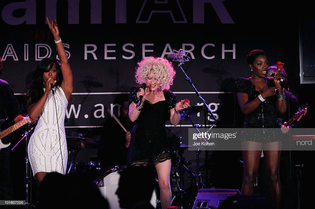 Singer Kelly Rowland Cyndi Lauper and Estelle at the 2010 amfAR New York Inspiration Gala at The New York Public Library on June 3 2010 in New York...