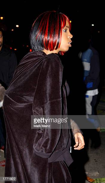 Singer Kelly Rowland exits the Reebok and JayZ launch of 'S Carter Collection by RBK' at the Velvet Room February 8 2003 in Atlanta Georgia As part...